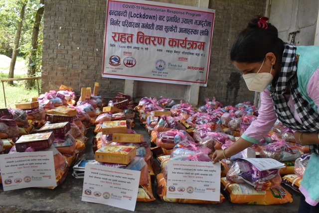 Kopila Chaulagain lives in Parsa District in Nepal, pictured organising aid packages for vulnerable women as part of ActionAid's covid-19 response worldwide